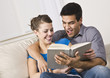 Cute Couple Reading and Laughing Together