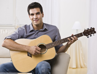 Relaxed Man Playing Guitar