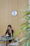 Business woman using mobile phone in conference room
