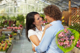 couple hugging in flower nursery poster