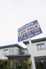 For sale sign outside house