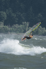 Man jumping whilst windsurfing