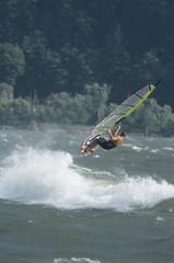 Man jumping whilst windsurfing