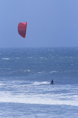 Person kitesurfing in sea