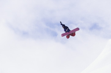 Person on snowboard, jumping, view from below