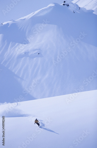 Snowboarder on slope, elegated view