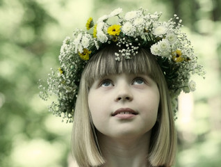 The girl in a flower wreath.