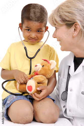 female doctor playing with a child