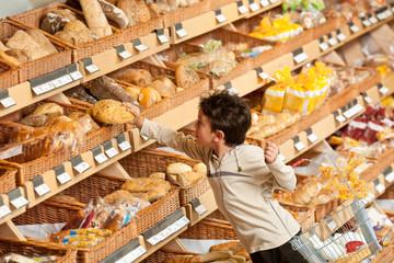 Shopping series - Little boy buying bread