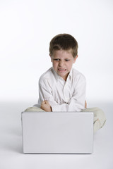 Angry child with computer