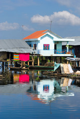 Modern and old  House on the river,  Cambodia.