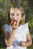 Portrait of girl 5-6 eating apple
