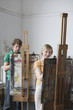 Two artists painting in studio