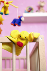 Crib with toys, focus on foreground