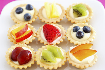 Selection of mini fruit cupcakes, elevated view