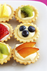 Close-up of mini fruit cupcakes, elevated view