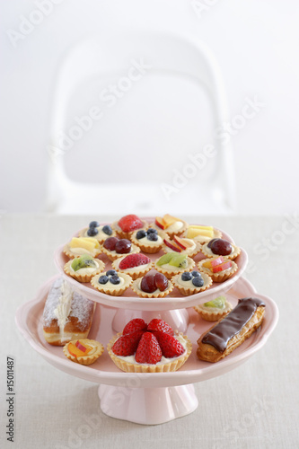 pastry and different cupcakes on serving plate, elevated view