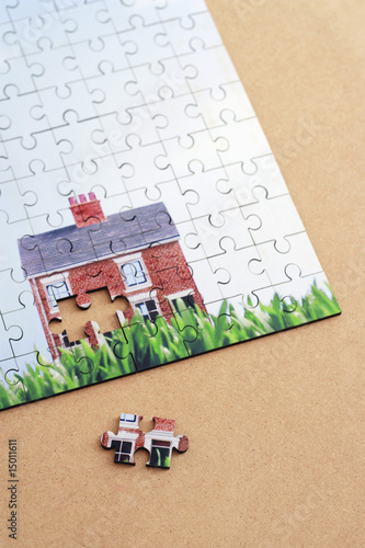Jigsaw puzzle with house, elevated view