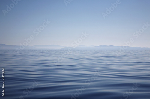 Ocean with hazy mountain shore