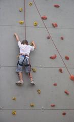 Girl climbing the wall