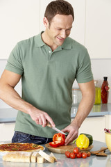 Man Preparing Meal In Kitchen