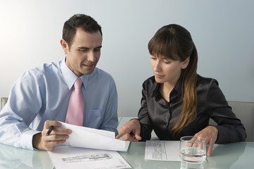 Business man and woman working at table in office