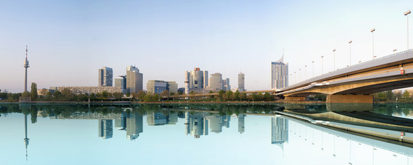 View on a modern city with a water reflection