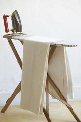 Iron and fabric on ironing board