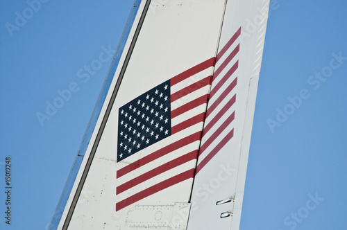 american flag on tail of airplane.