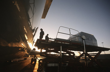 Loading freight onto Boeing 727 jet aircraft