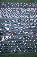 Cars and trucks parked in carpark, view from above