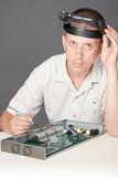 Engineer repairing circuit board poster