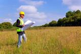 Architect surveying a new building plot - 15023849