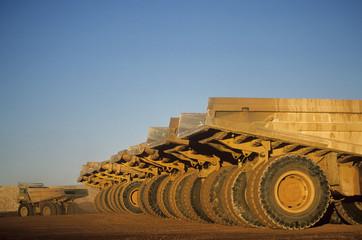 Ore hauling trucks in row, Telfer, Western Australia