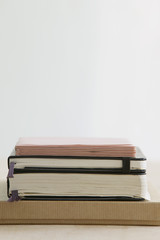 Stack of books and paper stationery, studio shot