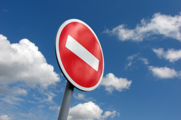 Prohibiting roadsign at the blue sky with clouds