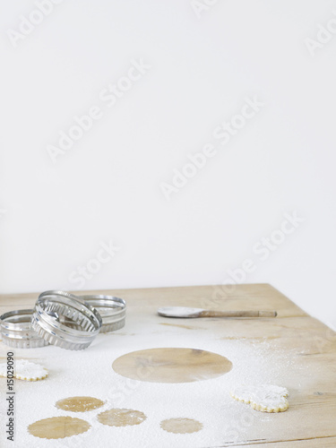 Pastry cutters and flour on table top