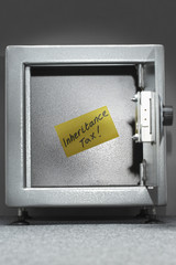 Safe with sticky note reading 'inheritance tax'
