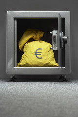 Sack with Euro symbol in safe