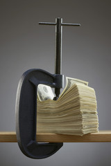 Vise gripping stack of banknotes