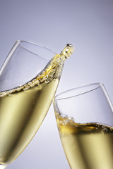 Two champagne glasses toasting, close-up