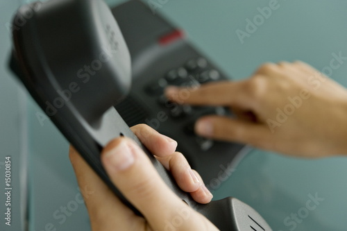 Closeup of woman's hands telephoning