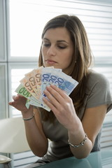 Professional woman counting euro bills