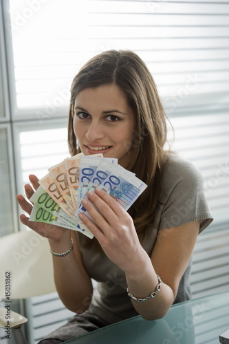 Professional woman holding euro bills