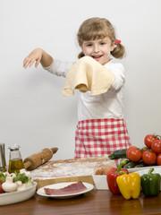 Little girl making pizza