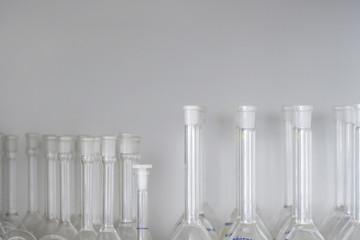 Laboratory flasks on shelf