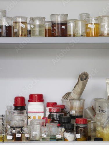Bottles and lab flasks on shelves