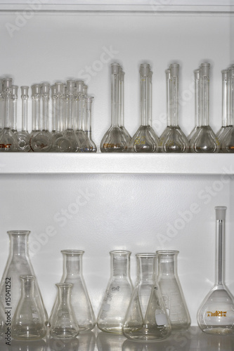 Laboratory flasks on shelves