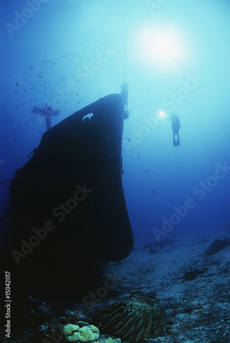 Diver exploring bow of sunken fishing trawler