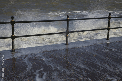 Water crashing over rail